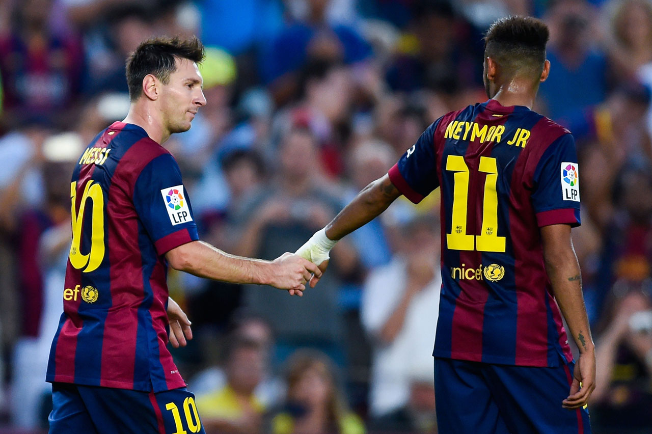 Messi giving his hand to Neymar