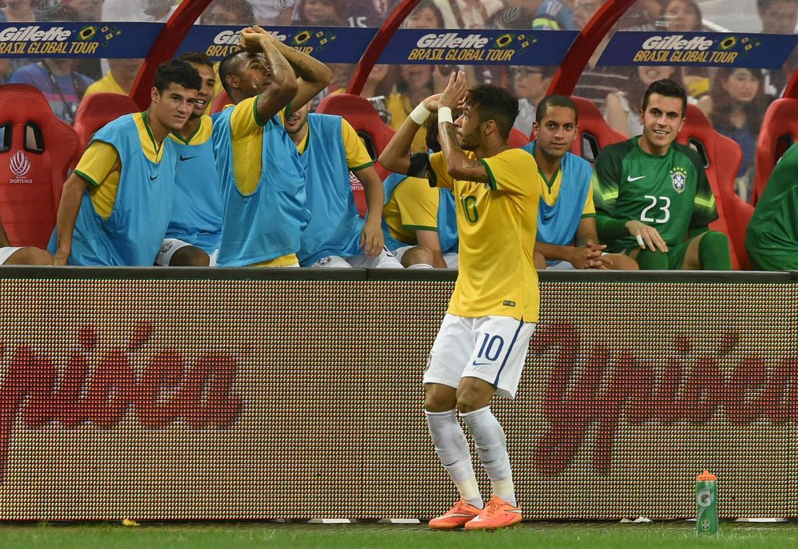 Neymar celebrating a goal with a 3-point basketball throw gesture