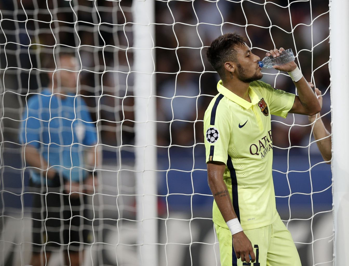 Neymar drinking from the bottle