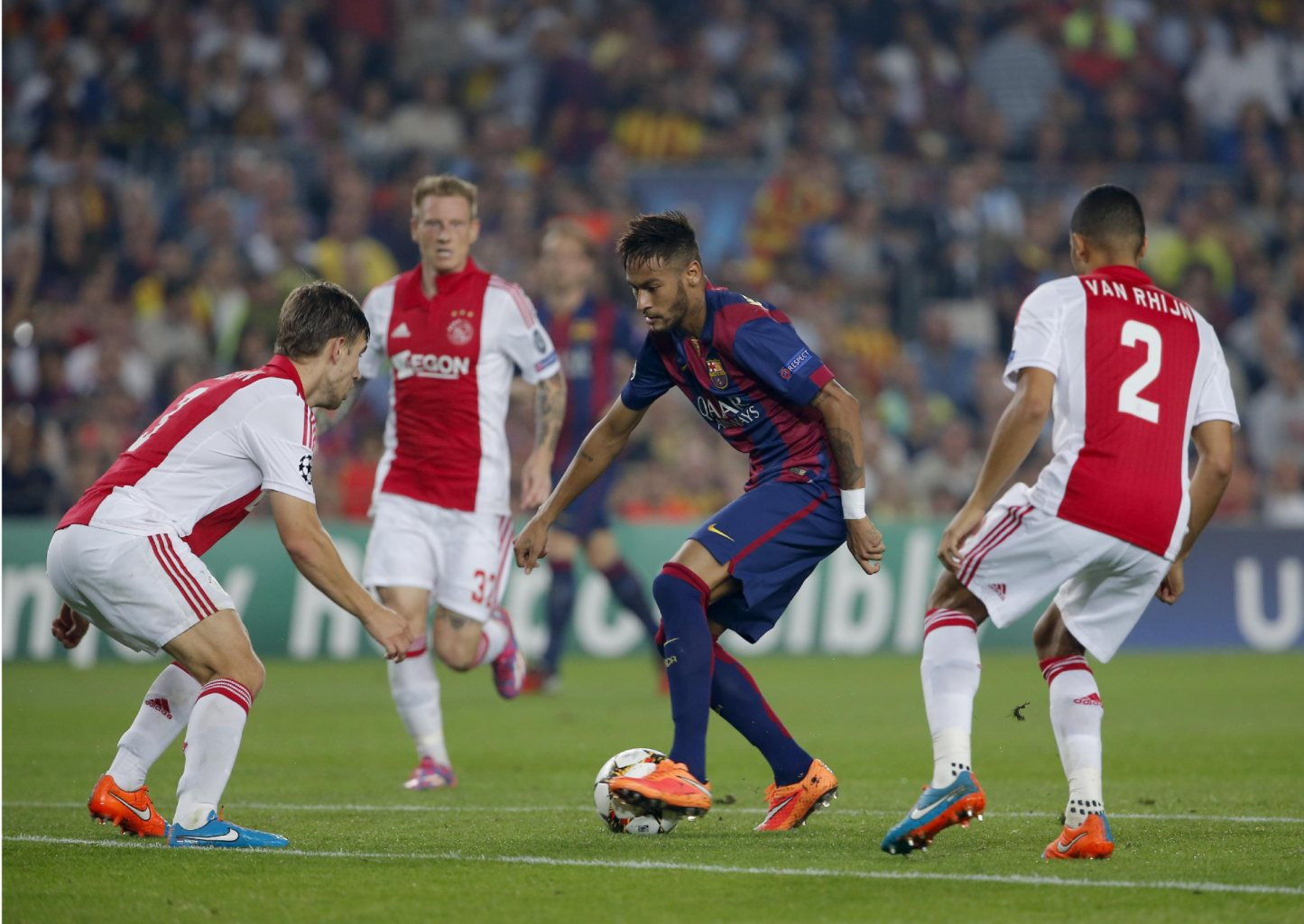 Neymar surrounded by Ajax defenders