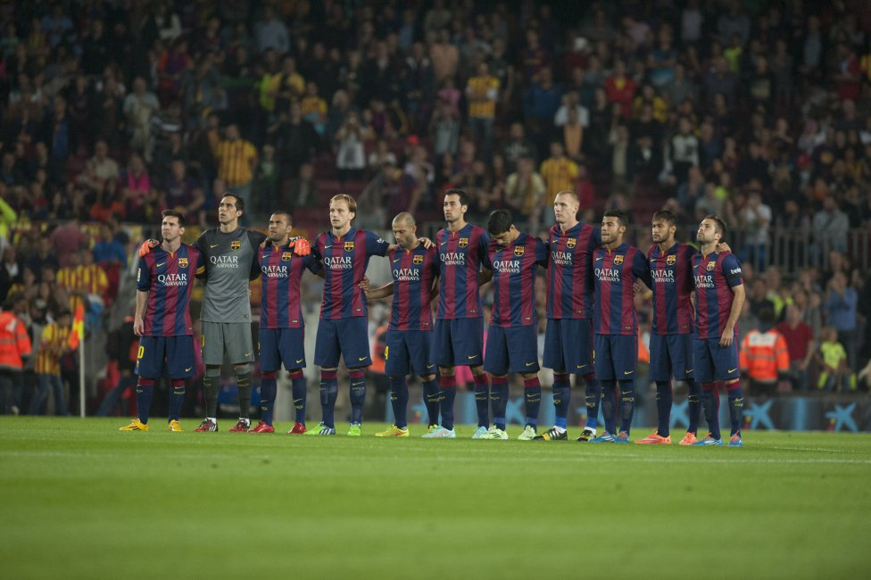 Barcelona players lining up for a minute of silence at the Camp Nou