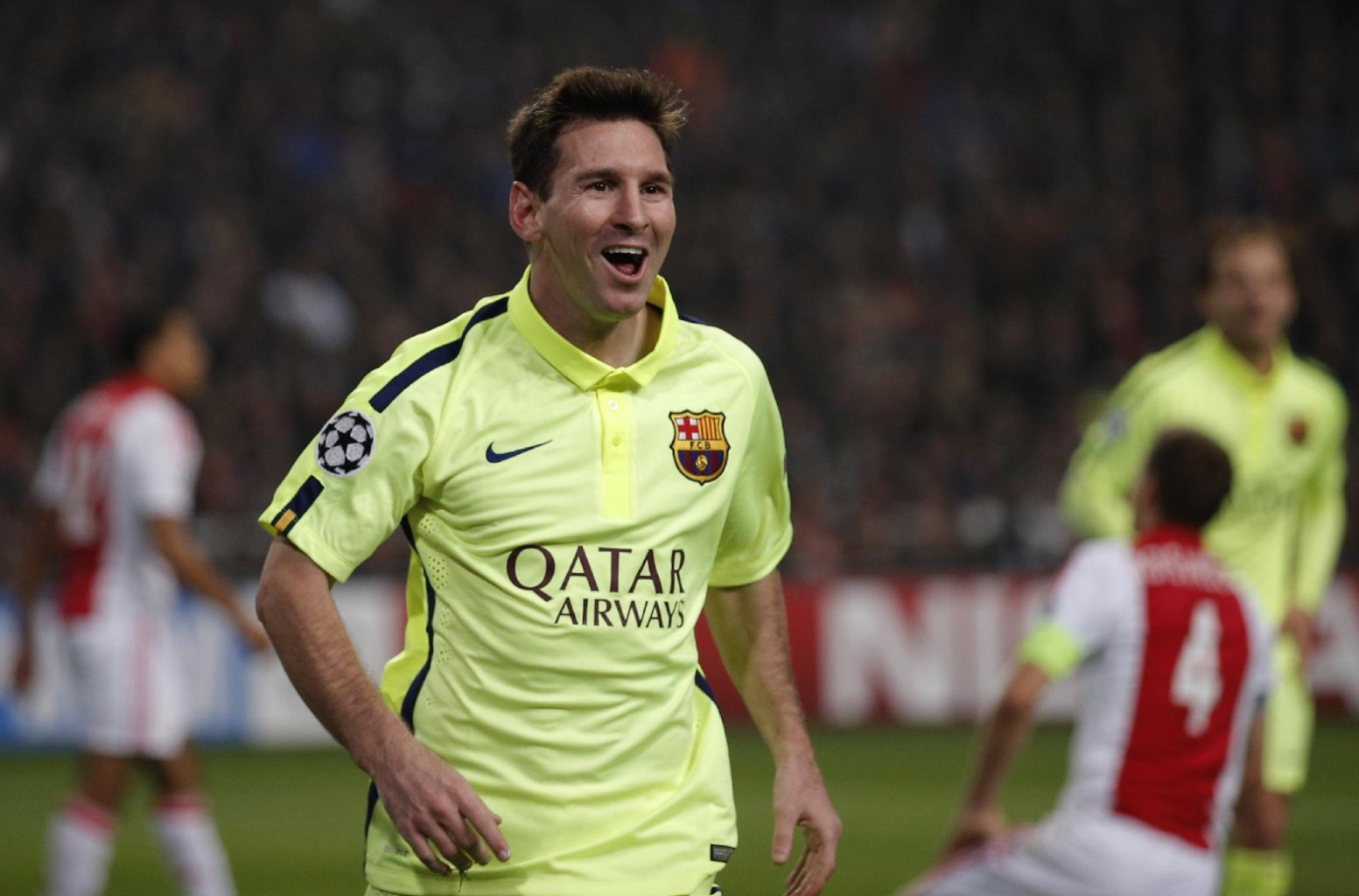 Lionel Messi celebrates scoring a brace for Barcelona, in the UEFA Champions League