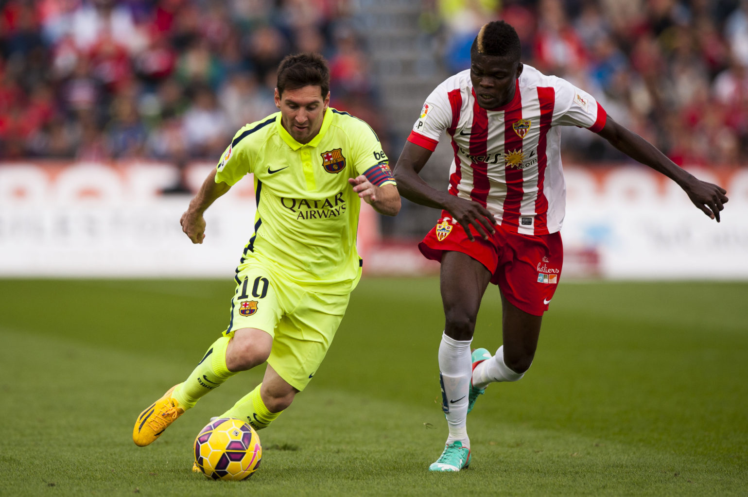 Lionel Messi running past a defender in Almeria vs Barcelona