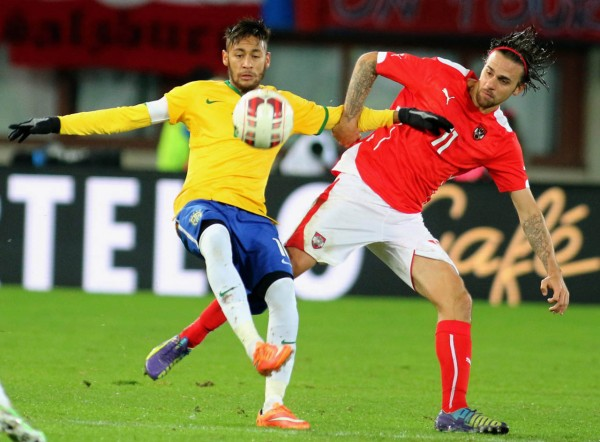 Neymar attempting to keep the ball in his control in Austria vs Brazil