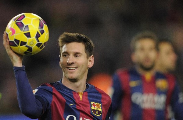 Lionel Messi holding his hat-trick match ball, in Barcelona 5-1 Espanyol