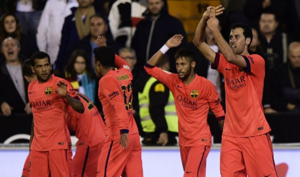 Sergio Busquets celebrating Barcelona goal with his teammates