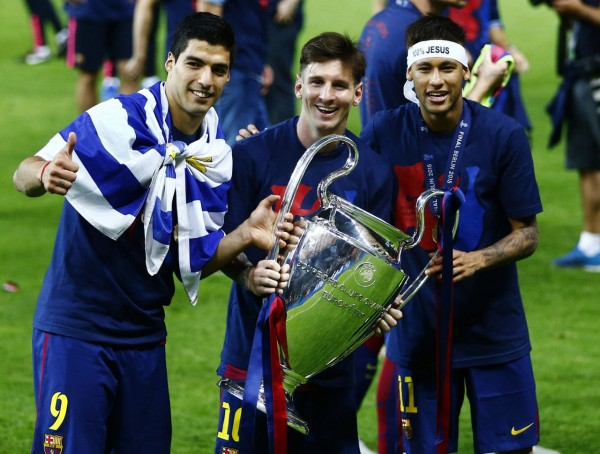 Suarez, Messi and Neymar holding the UEFA Champions League trophy in 2015