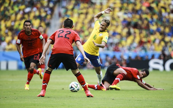 Neymar getting taclked in a game for Brazil