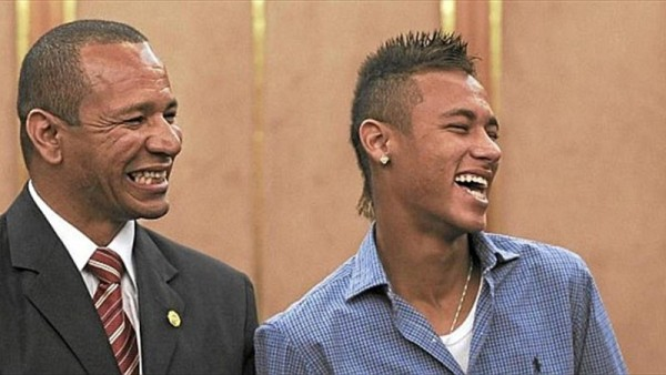 Neymar next to his father