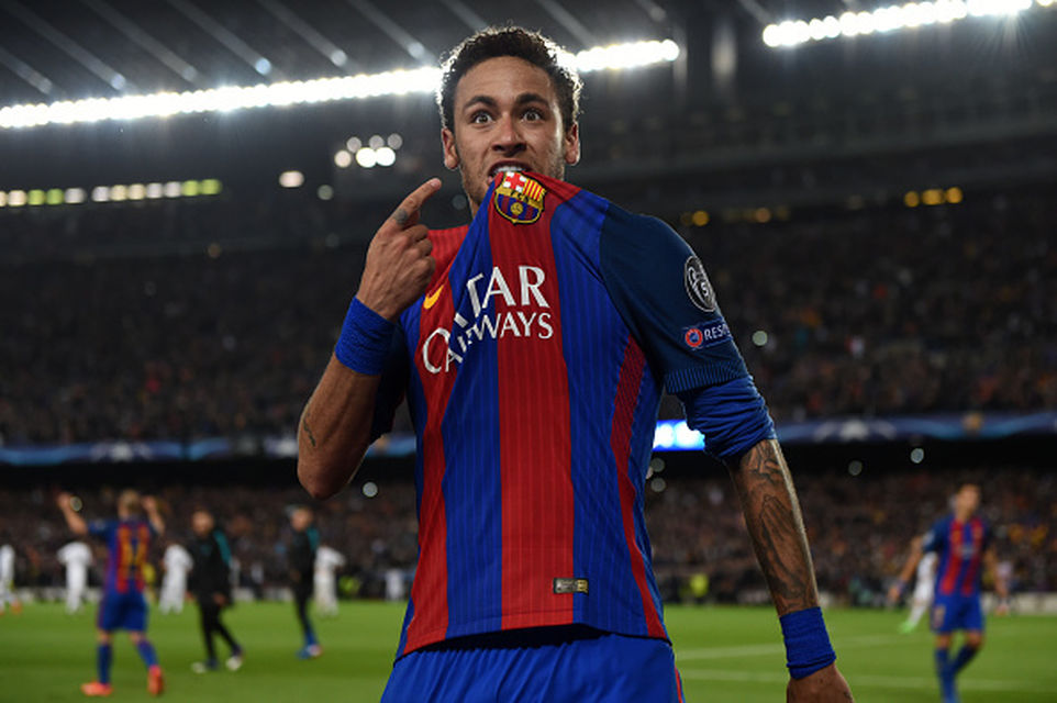 Neymar bites his shirt and points to Barcelona badge