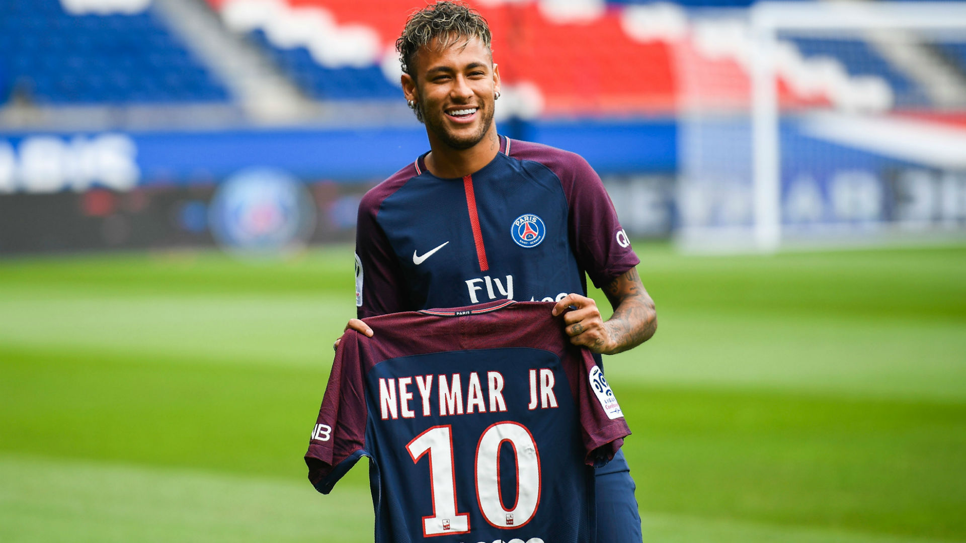 Neymar holding his PSG number 10 shirt