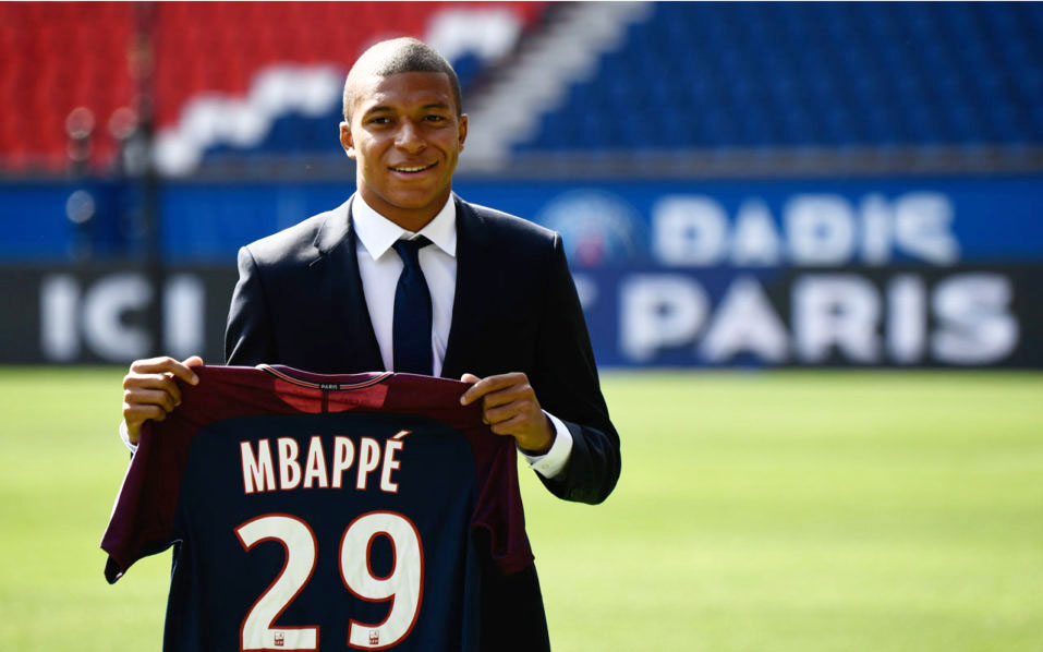 Kylian Mbappé with his PSG jersey